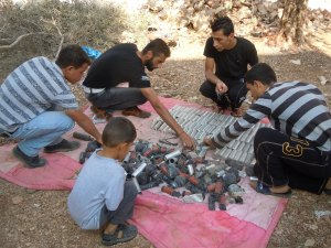 Arranging Ammunition ~ Haris Village ~ Photo Credit: Dawn